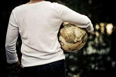 Social Impact Bonds Image - Woman Holding Globe