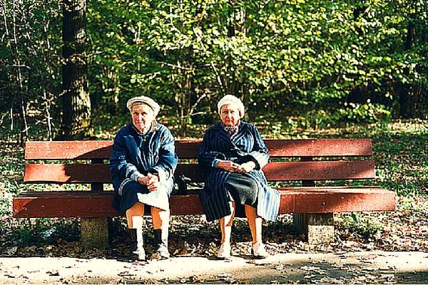 Image of two women sitting on a park bench